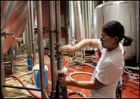 A worker at the Goose Island Brewery in Chicago prepares a fermenting vessel