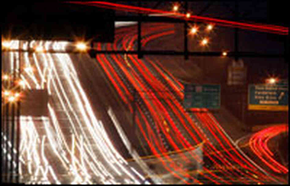 Thanksgiving traffic pictured at night.