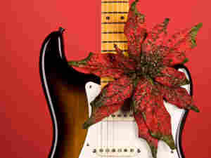 Guitar with a red flower.