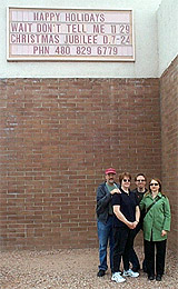 Andy Rosenberg, Lorna White, Mike Danforth, and Diantha Parker under the sign outside the Red River Music Hall in Tempe, Ariz.