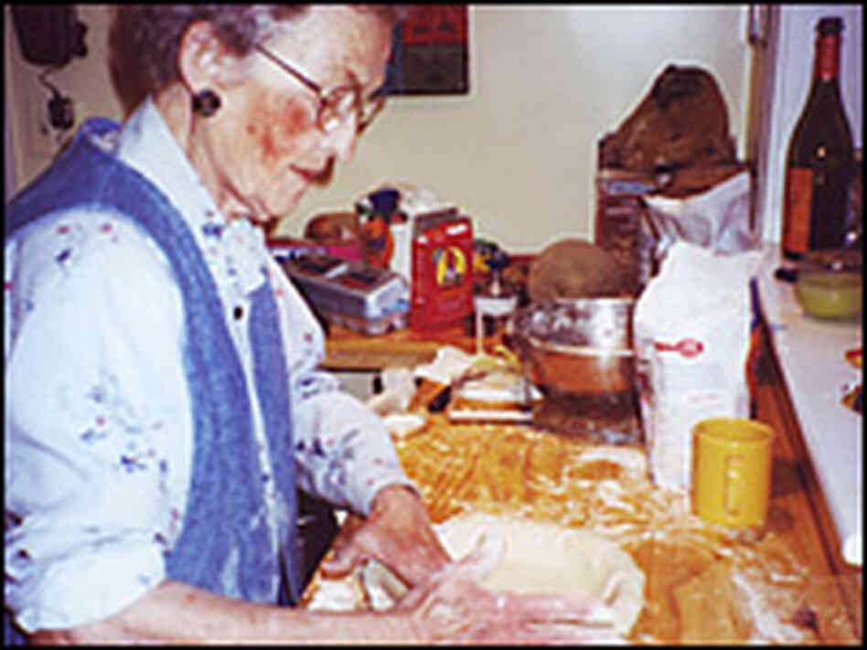 Marion Otte, Jennifer Ludden's grandmother, presses down pie dough.