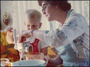 A young Alton Brown cooking with his grandmother.