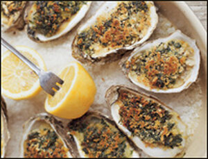 Baked oysters with slab bacon and wilted greens.