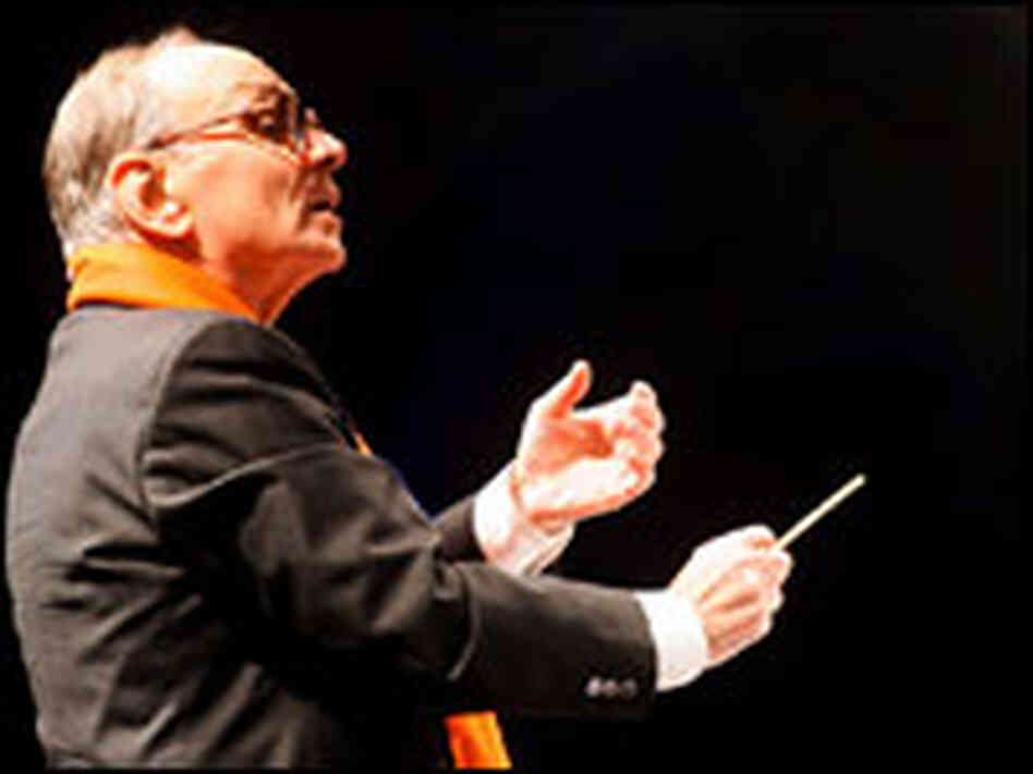 Composer Ennio Morricone conducts the Sinfonietta Orchestra in Milan, Dec. 16, 2006.