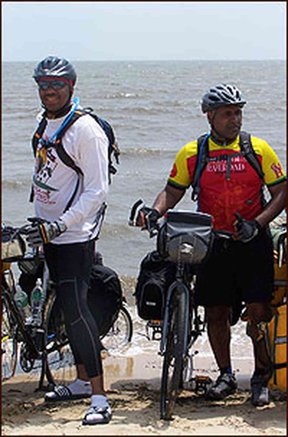 Cyclists Dip Their Bike Wheels in the Gulf of Mexico