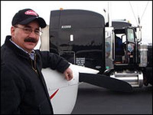 Steve Brosnan stands by his truck.