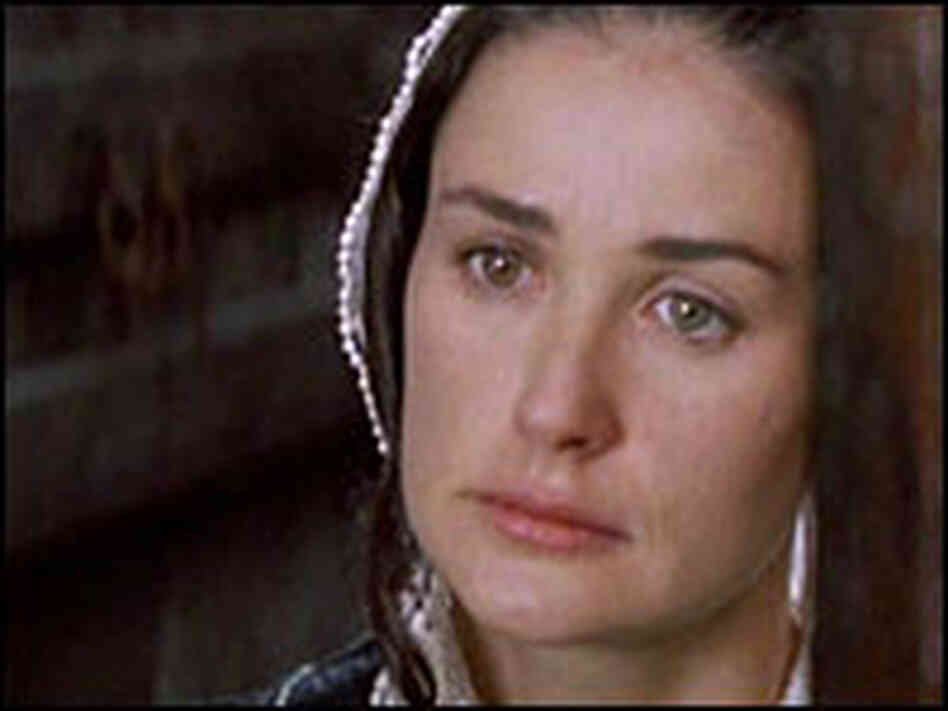 Demi Moore as Hester Prynne.