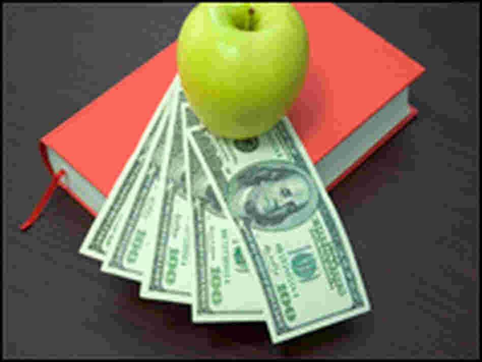 An apple, books and money.