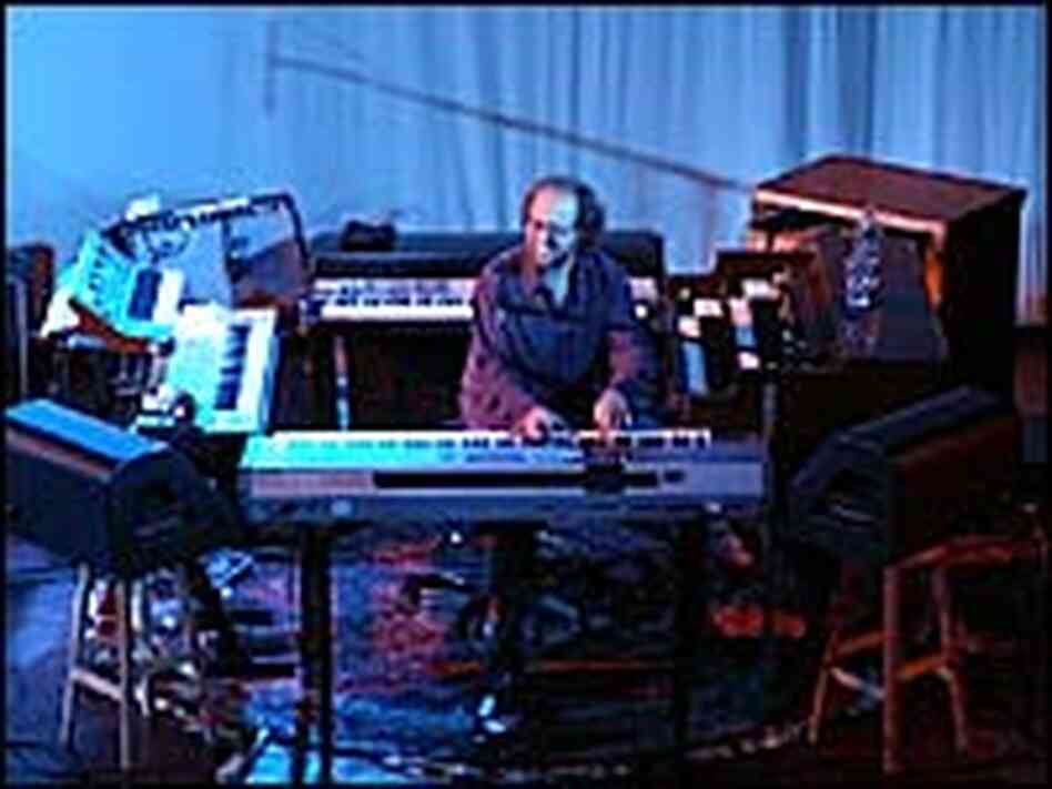 Page McConnell, surrounded by keyboards
