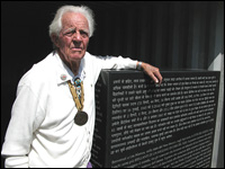 "Ed Grothus, seen here with one of his ""Doomsday Stones"" — on which will sit a 32-foot granite obelisk inscribed with a screed against nuclear bombs, translated into 15 languages."