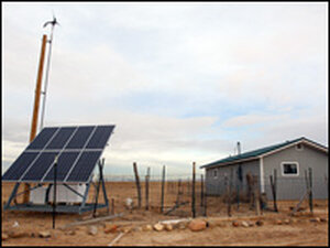 A solar panel and wind turbine in New Mexico.