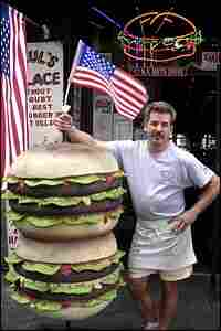 """Paul Kovalevich stands outside his """"burger joint."""""""