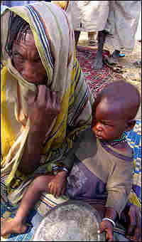Hawaye Ismail from Mitematko, a small village near Chad's border with Darfur, and child.