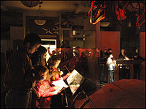 Sleepover participants on a flashlight tour at the American Museum of National History.
