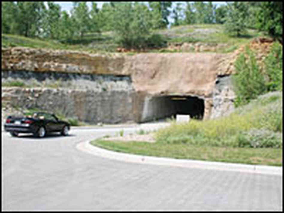 A car enters the entrance to the caverns where records are held.