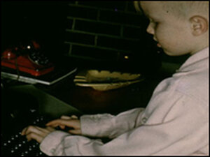 A young Bryson at his father's typewriter.
