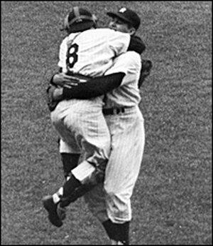 Yankee catcher Yogi Berra (left) hugs teammate Don Larsen