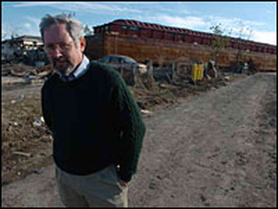 Mark Schleifstein in the Lower Ninth Ward, standing in front of beached barge