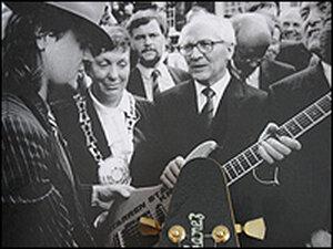 former East German leader Erich Honecker inspects an Ibanez electric guitar