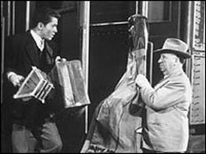 Farley Granger and Alfred Hitchcock in Strangers on a Train