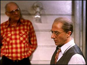 Arthur Miller leans against wall; Dustin Hoffman in character