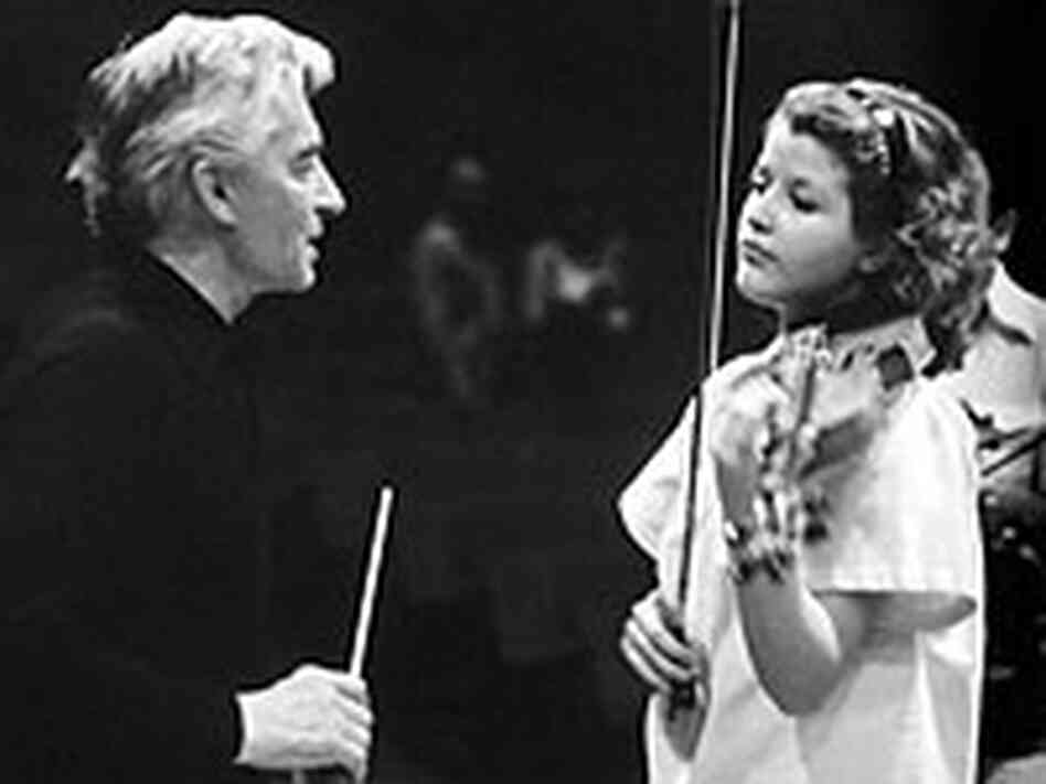 Violinist Anne-Sophie Mutter with conductor Herbert von Karajan