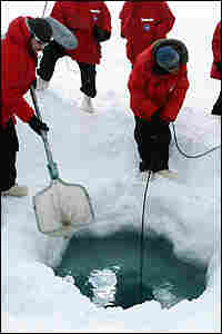 Researchers lower canister into ice hole