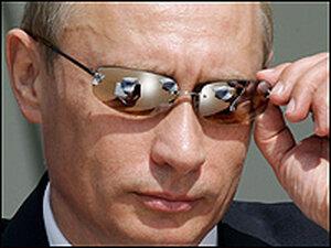 Russian President Vladimir Putin looks at demonstration flights.