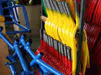 Freshly painted bike frames at Worksman Cycles.
