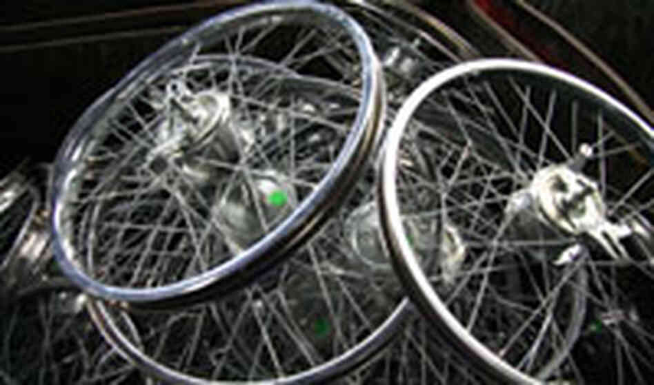 Heavy-duty wheels for bicycles, tricycles and carts made by Worksman Cycles.