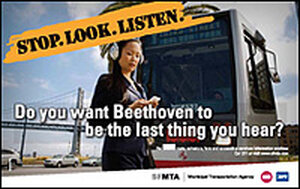 An ad warns pedestrians to pay attention.San Francisco Municipal Transportation Agency