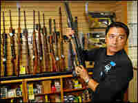 A gun store salesman