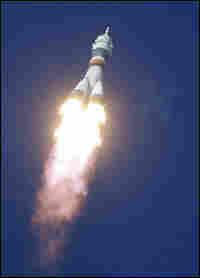 A Russian Soyuz rocket blasts off.