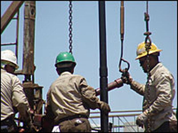 Oil workers operate a rig in Midland County, Texas, in June 2008. (AFP/Getty Images)