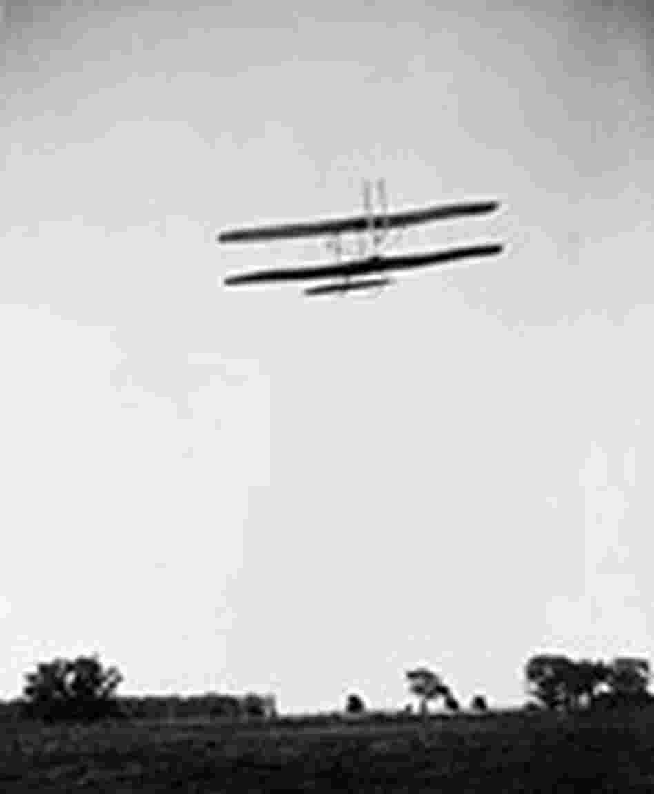 Orville Wright flying over Huffman Prairie.