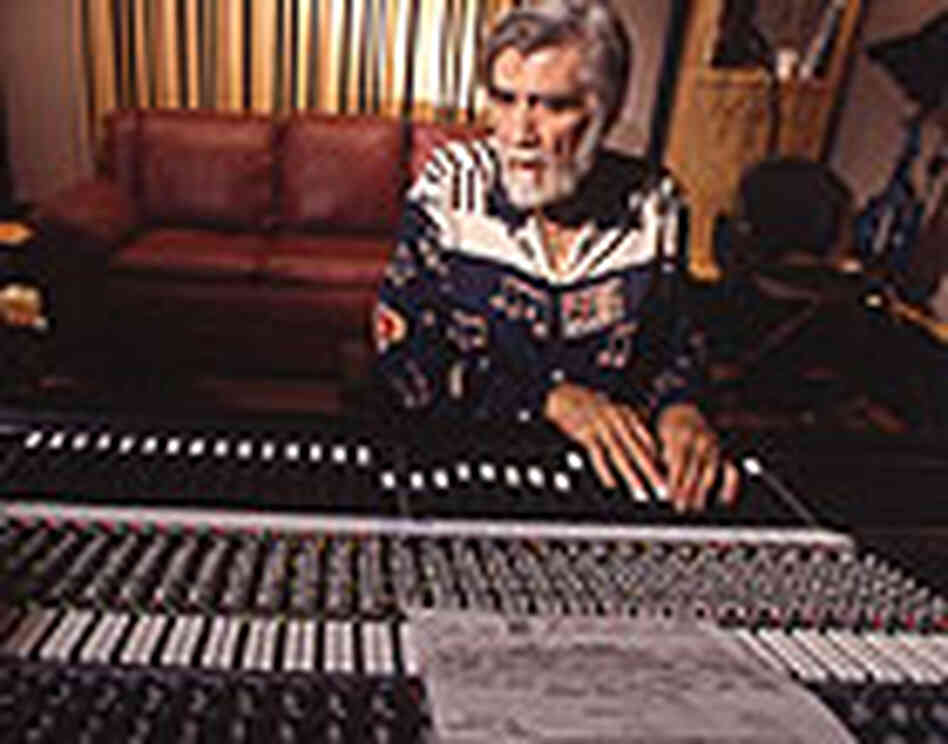 "Tom Dowd at a mixing board with the sheet music for ""Layla."""