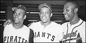 Roberto Clemente, Willie Mays and Henry Aaron pose in an All-Star Game locker room.