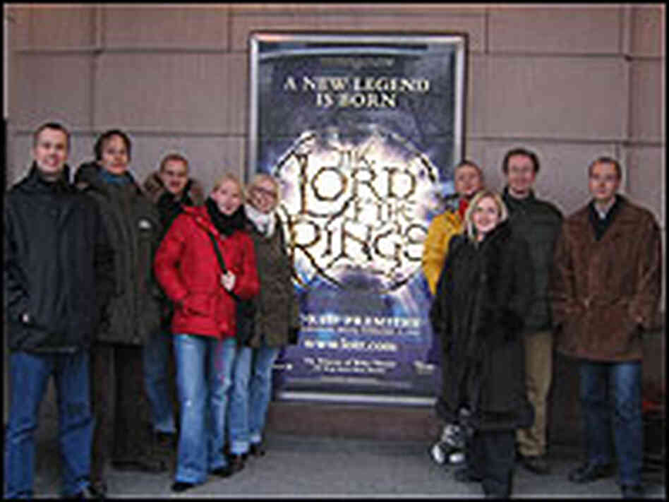 The whole group poses outside The Princess of Wales Theatre in Toronto.