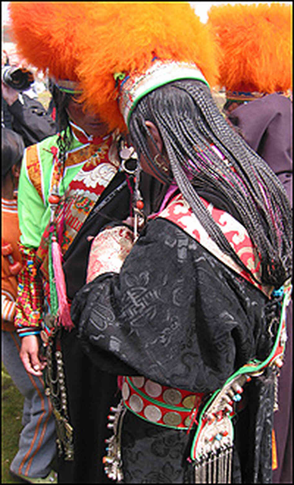 Khampa women dress up for the horse festival, braiding their hair into 108 strands.