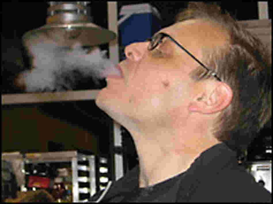 Culinary wizard Alton Brown exhales a breath of liquid nitrogen, used to freeze eggnog.
