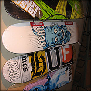 Skateboards on the wall, one with a Tommy Guerrero design.