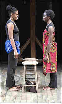 Nikkole Salter and Danai Gurira stand face to face on stage.