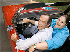 Food writers Jane and Michael Stern in their convertible.