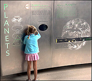 A young visitor at the American Museum of Natural History's Cullman Hall of the Universe.