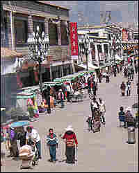 Pilgrims and pedestrians walk along the Barkhor street in Lhasa.