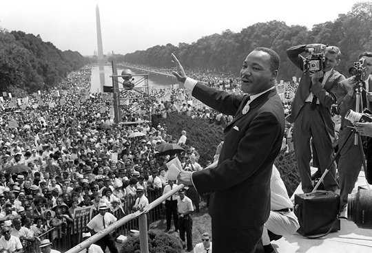 Dr. Martin Luther King, Jr gestures to the crowd during the March on Washington for Jobs and Freedom, August 1963