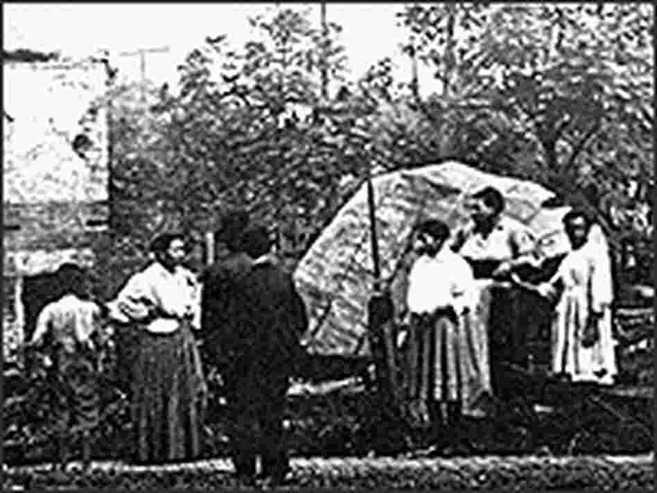 Black riot victims view the remains of their burned homes.
