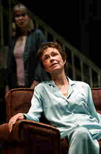 Deanna Dunagan sits on a sofa;  Amy Morton hovers in the background