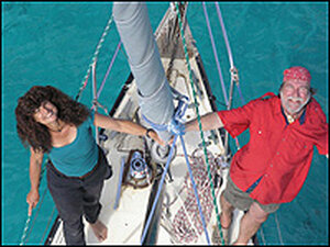Captain Fatty Goodlander and his wife, Carolyn, on the bow of the Wild Card.