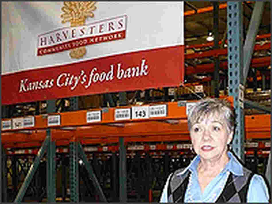 CEO Karen Haren stands in an empty warehouse run by Harvesters, a community food network.